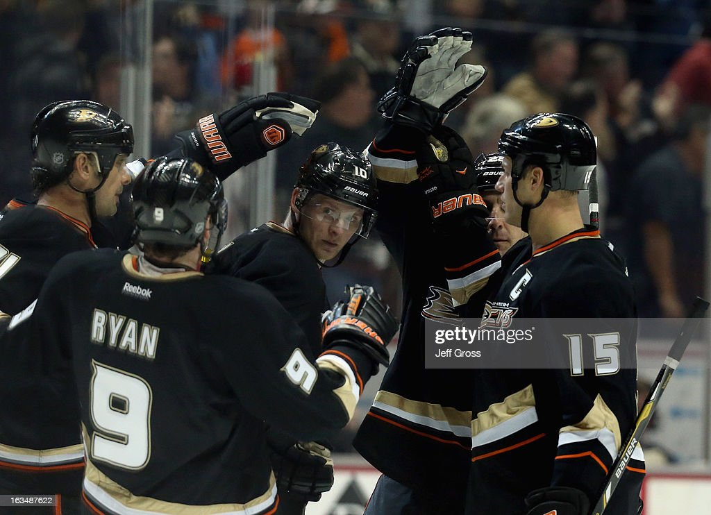 <a gi-track='captionPersonalityLinkClicked' href=/galleries/search?phrase=Sheldon+Souray&family=editorial&specificpeople=203131 ng-click='$event.stopPropagation()'>Sheldon Souray</a> #44, <a gi-track='captionPersonalityLinkClicked' href=/galleries/search?phrase=Bobby+Ryan&family=editorial&specificpeople=877359 ng-click='$event.stopPropagation()'>Bobby Ryan</a> #9, <a gi-track='captionPersonalityLinkClicked' href=/galleries/search?phrase=Corey+Perry&family=editorial&specificpeople=213864 ng-click='$event.stopPropagation()'>Corey Perry</a> #10 and <a gi-track='captionPersonalityLinkClicked' href=/galleries/search?phrase=Ryan+Getzlaf&family=editorial&specificpeople=602655 ng-click='$event.stopPropagation()'>Ryan Getzlaf</a> #15 of the Anaheim Ducks celebrate a goal by Perry against the St. Louis Blues in the third period at Honda Center on March 10, 2013 in Anaheim, California. The Ducks defeated the Blues 4-2.