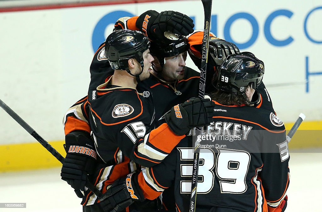 Sheldon Souray #44 (C) is congratulated by Ryan Getzlaf #15 and Matt Beleskey #39 of the Anaheim Ducks after scoring a seoncd period goal against the Los Angeles Kings at Honda Center on February 2, 2013 in Anaheim, California.