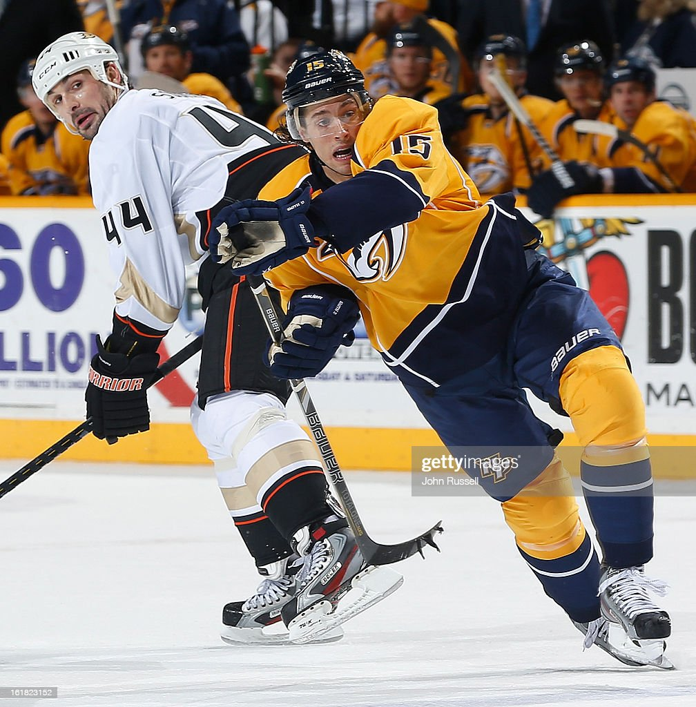 <a gi-track='captionPersonalityLinkClicked' href=/galleries/search?phrase=Sheldon+Souray&family=editorial&specificpeople=203131 ng-click='$event.stopPropagation()'>Sheldon Souray</a> #44 of the Anaheim Ducks checks Craig Smith #15 of the Nashvile Predators during an NHL game at the Bridgestone Arena on February 16, 2013 in Nashville, Tennessee.