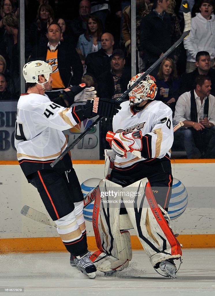 Sheldon Souray #44 of the Anaheim Ducks congratulates teammate Viktor Fasth #30 on defeating the Nashville Predators in a shootout at the Bridgestone Arena on February 16, 2013 in Nashville, Tennessee.