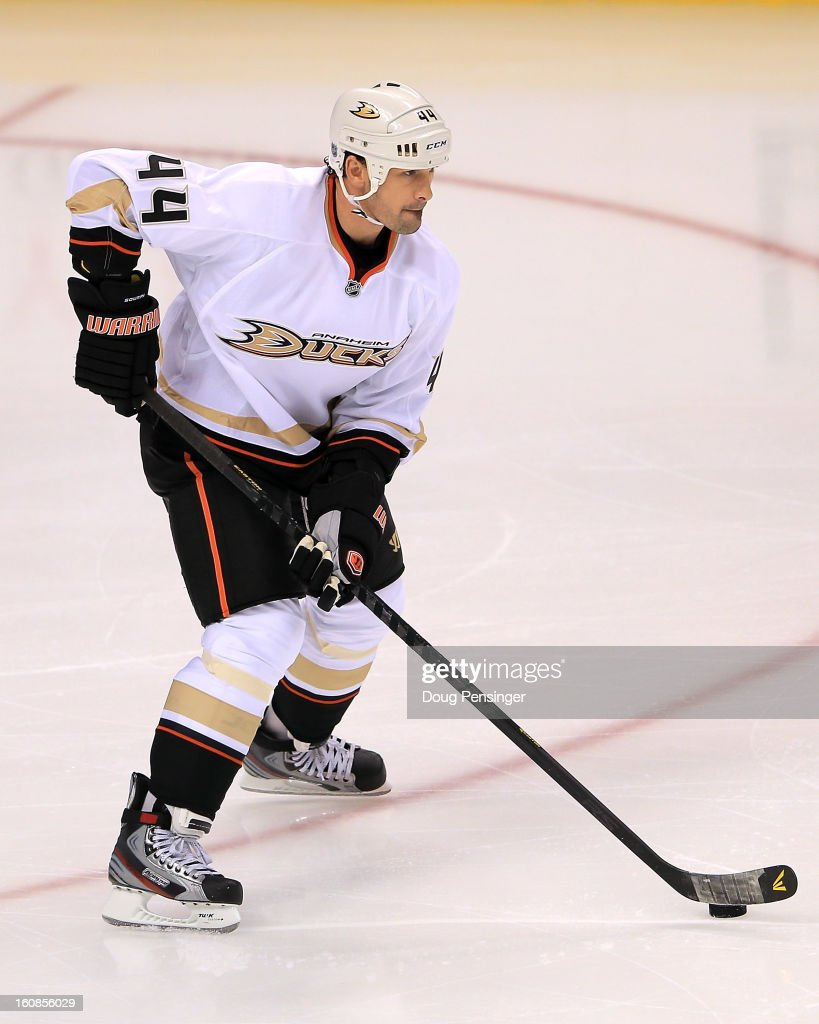 Sheldon Souray of the Anaheim Ducks controls the puck against the Colorado Avalanche at the Pepsi Center on February 6 2013 in Denver Colorado The...