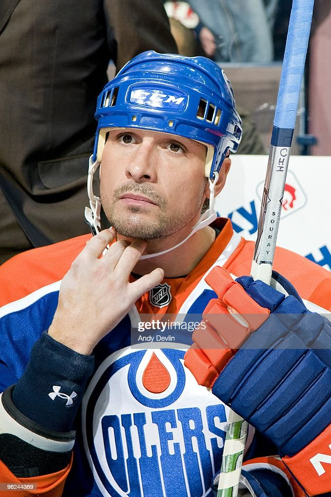Sheldon Souray of the Edmonton Oilers adjusts his helmet before a game against the Chicago Blackhawks at Rexall Place on January 26 2010 in Edmonton...