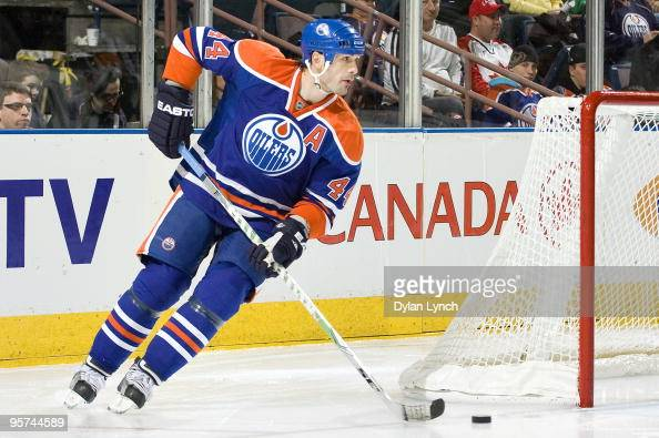 Sheldon Souray of the Edmonton Oilers breaks out from behind the net with the puck during a game against the Phoenix Coyotes at Rexall Place on...