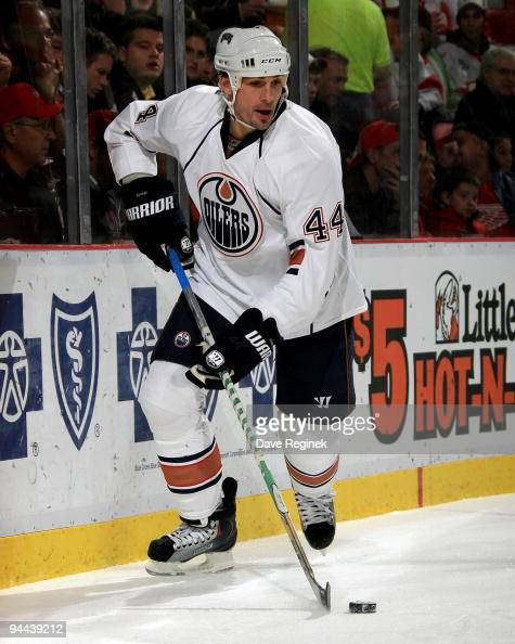 Sheldon Souray of the Edmonton Oilers controls the puck during a NHL game against the Detroit Red Wings at Joe Louis Arena on December 3 2009 in...