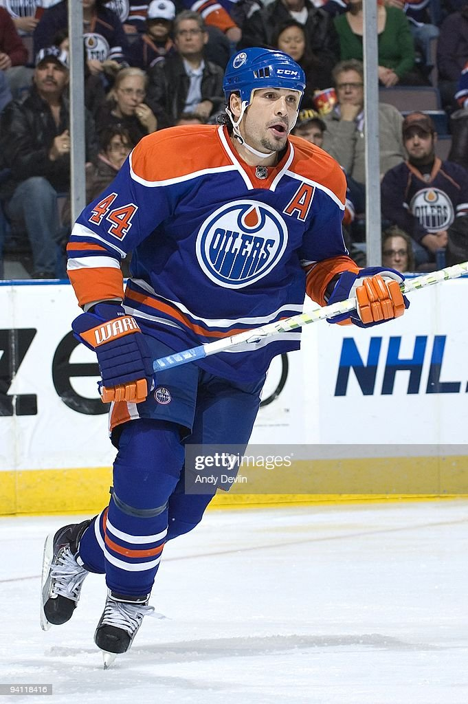 Sheldon Souray of the Edmonton Oilers follows the play against the San Jose Sharks at Rexall Place on November 27 2009 in Edmonton Alberta Canada The...