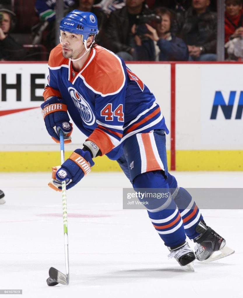 Sheldon Souray of the Edmonton Oilers skates up ice with the puck during their game against the Vancouver Canucks at General Motors Place on November...