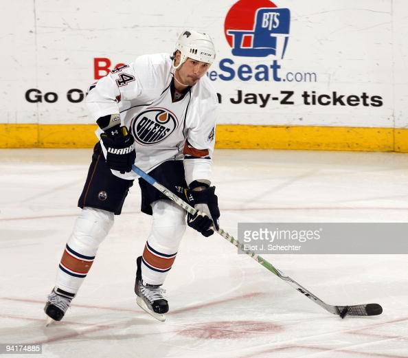 Sheldon Souray of the Edmonton Oilers skates with the puck against the Florida Panthers at the BankAtlantic Center on December 7 2009 in Sunrise...