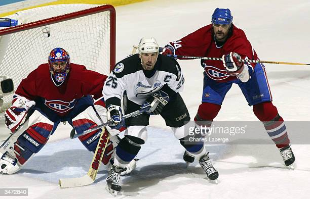 Sheldon Souray of the Montreal Canadiens battles for crease position against Dave Andreychuck of the Tampa Bay Lightning in front of Canadiens goalie...
