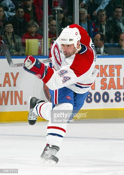 Sheldon Souray of the Montreal Canadiens passes the puck during the game against the New York Islanders on December 7 2006 at the Nassau Coliseum in...