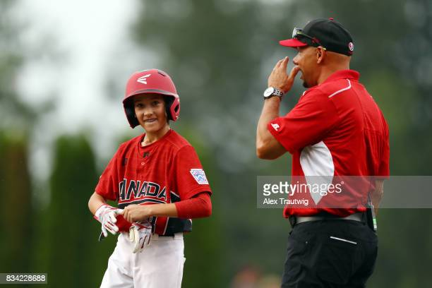 Sheldyn Scott of the Canada team from British Columbia stands on first base during Game 3 of the 2017 Little League World Series against the Europe...