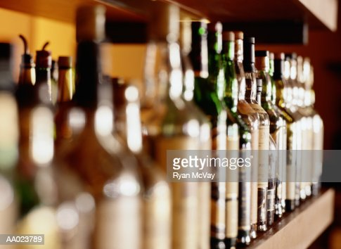 Shelf of liquor bottles (differential focus : Stock Photo