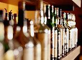 Shelf of liquor bottles (differential focus