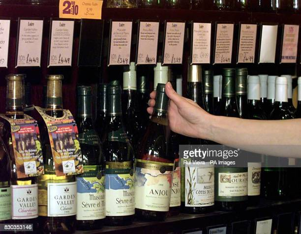 A shelf with bottles of wine at an Off Licence in Ashby De La Zouch on the day that Britain's Chancellor Gordon Brown announced in his Budget that...
