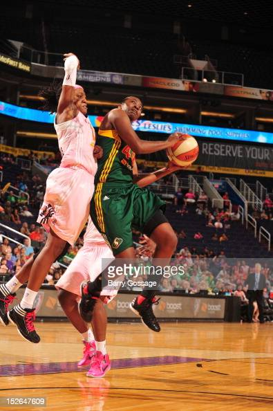 Shelinna Stricklen of the Seattle Storm shoots against Alexis Hornbuckle of the Phoenix Mercury on September 23 2012 at US Airways Center in Phoenix...