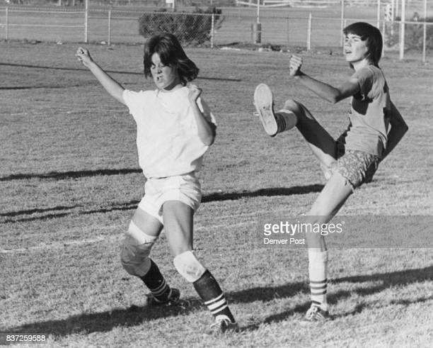 She'll Get A Kick Out Of This Victory Cindy Hall star halfback of the Golden Bombers appears to be the target of a boot from Sharon Burrill of the...