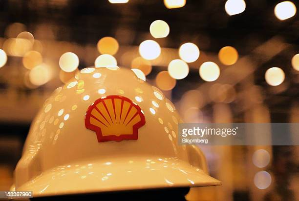 A Shell logo is seen on a safety helmet worn by an employee at Royal Dutch Shell Plc's new lubricants blending plant in Torzhok Russia on Wednesday...