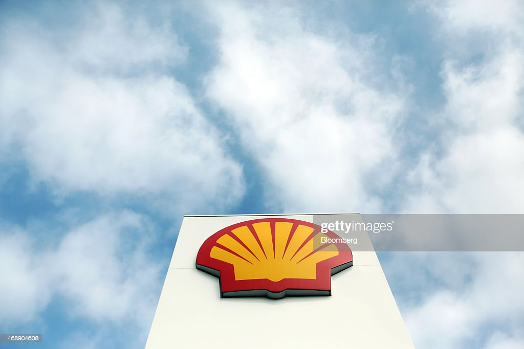 A Shell logo sits on a sign outside a gas station operated by Royal Dutch Shell Plc in ClactononSea UK on Wednesday April 8 2015 Shell agreed to buy...