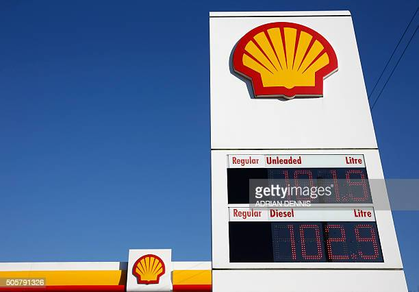 Shell logos are pictured outside a Royal Dutch Shell petrol station in Hook near Basingstoke on January 20 2016 Royal Dutch Shell said it expected a...