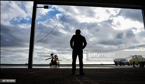 Shell Oil President Marvin Odum tours the helicopter hangers as he checks in on their Arctic drilling efforts on September 2 2015 in Barrow AK