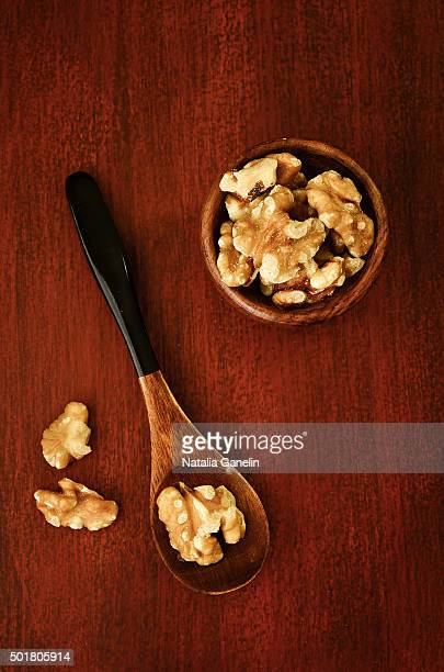Shelled walnuts on wooden table