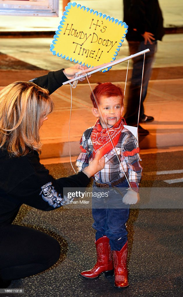 Shelley Brittell of Nevada adjusts her 3-year-old son Jaden Brittell's Howdy Doody outfit as they compete in a costume contest during the fourth annual Las Vegas Halloween Parade on October 31, 2013 in Las Vegas, Nevada.