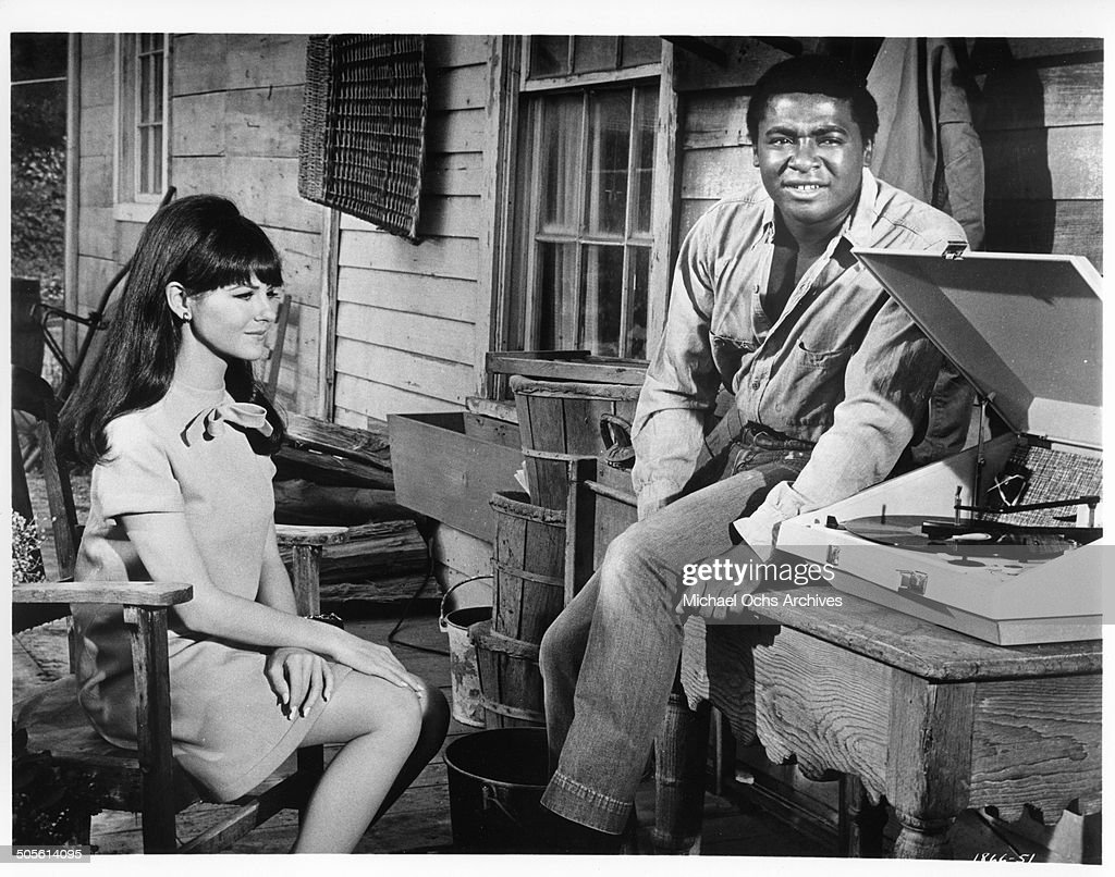 Shelley Fabares and D'Urville Martin listen to the first smash hit record of their friend in a scene from the movie 'A Time to Sing' circa 1968