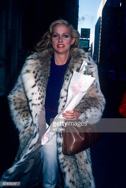 Shelley Hack wearing a fur coat carrying flowers circa 1970 New York