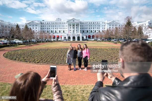 Shelley Mike Cummings take photos of Isabelle Gavin Juliet Cummings Grace Cataloni and Maddie Cummings with the Greenbrier in background They are...