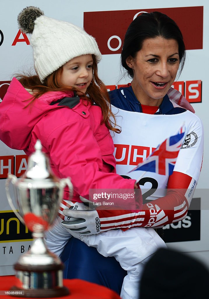 Shelley Rudman of Great Britain celebrates with her daughter Elli after winning the women's skeleton final heat of the IBSF Bob & Skeleton World Championship at Olympia Bob Run on February 1, 2013 in St Moritz, Switzerland.