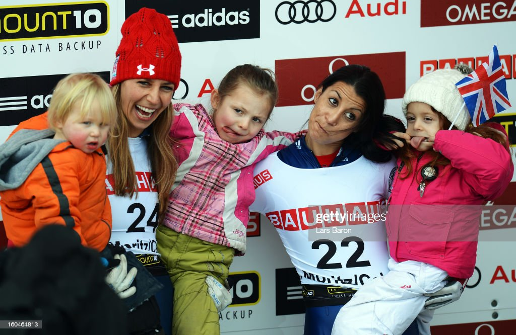 Shelley Rudman of Great Britain celebrates with her daughter Elli next to second placed Noelle Pikus Pace of USA and her kids after winning the women's skeleton final heat of the IBSF Bob & Skeleton World Championship at Olympia Bob Run on February 1, 2013 in St Moritz, Switzerland.