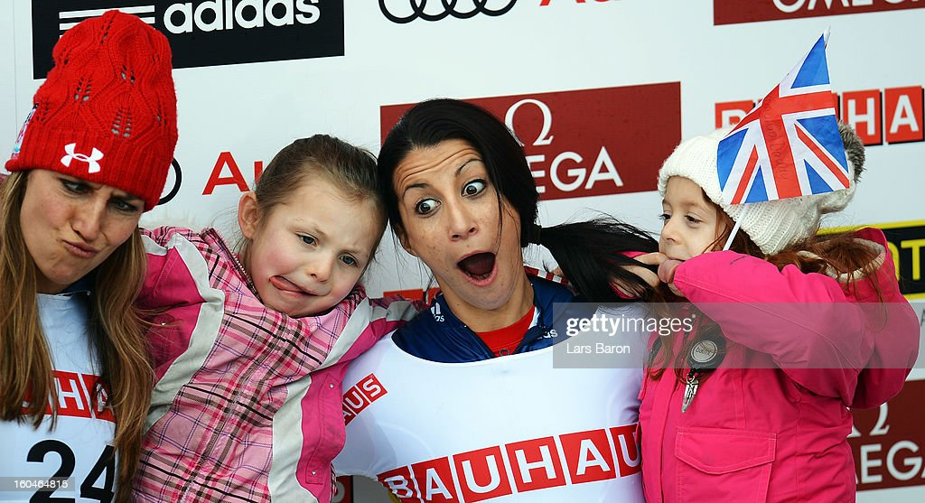 Shelley Rudman of Great Britain celebrates with her daughter Elli next to second placed Noelle Pikus Pace of USA and her kids after winning the...