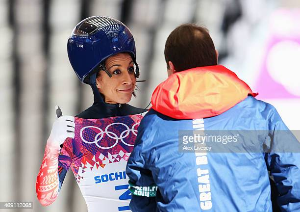 Shelley Rudman of Great Britain speaks to her coach after a run during the Women's Skeleton heats on Day 6 of the Sochi 2014 Winter Olympics at...