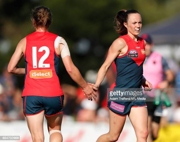 Shelley Scott of the Demons celebrates with Daisy Pearce of the Demons during the 2017 AFLW Round 07 match between the Melbourne Demons and the...
