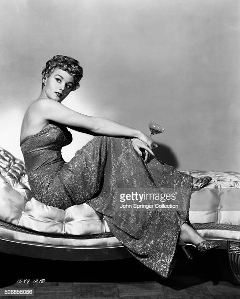 Shelley Winters Holding Martini Glass on Chaise Longue
