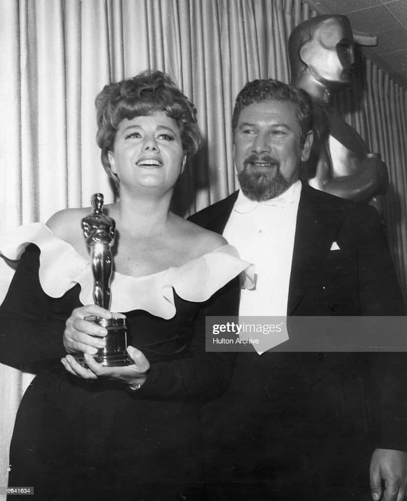 Shelley Winters, the American actress having been presented with an Oscar by Peter Ustinov, the English actor. She won the best supporting actress of the year award for her role in the film 'A Patch Of Blue'.