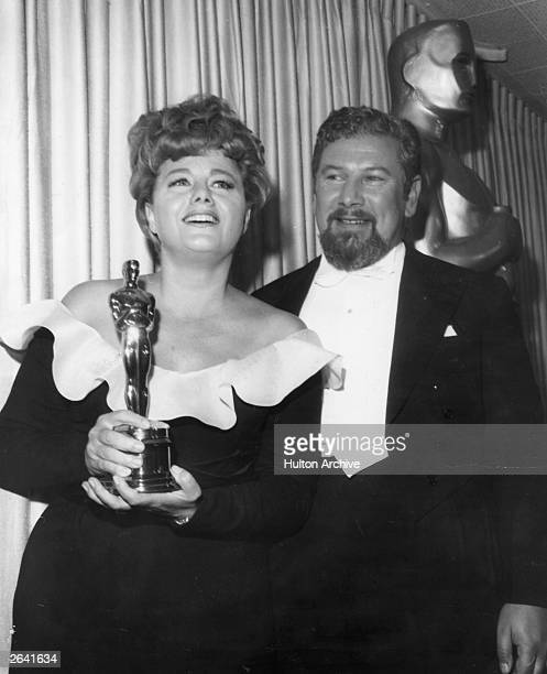 Shelley Winters the American actress having been presented with an Oscar by Peter Ustinov the English actor She won the best supporting actress of...