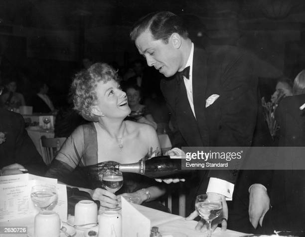 Shelley Winters the American film actress with Richard Attenborough at a party being held at the Lyceum