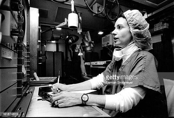 NOV 3 1987 Shelli Grogan a register nurse in the cardiac care unit at Presbyterian AMI Hospital monitors vital signs of a patient just treated for...
