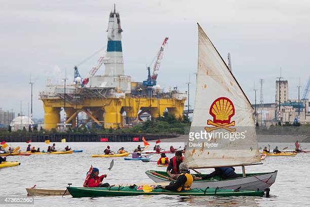 ShellNo flotilla participants float near the Polar Pioneer oil drilling rig during demonstrations against Royal Dutch Shell on May 16 2015 in Seattle...