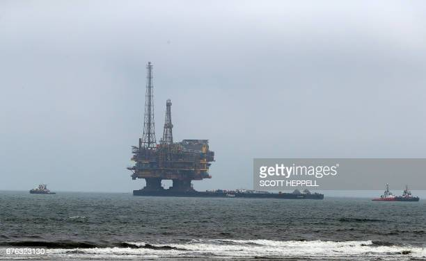 Shell's Brent Delta Topside offshore oil drilling rig platform is towed by tug boats along the coastline of Hartlepool to Able Seaton Port for...