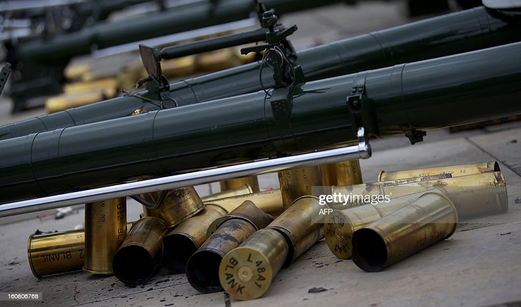 Shells from blank rounds lie on the floor after the Honourable Artillery Company (HAC), the City of London's Territorial Army Regiment, fired a 62 gun salute in honour of the 61st anniversary of Britain's Queen Elizabeth II's accession to the throne at the Tower of London on February 6, 2013. AFP PHOTO / ANDREW COWIE