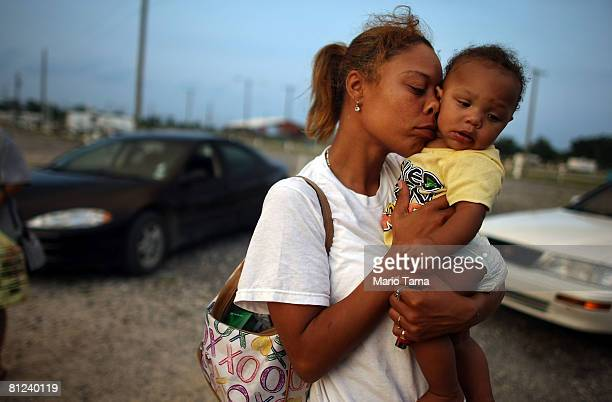 Shelly Phillips holds niece Kimmore Barthelemy in the FEMA Diamond travel trailer park May 26 2008 in Port Sulphur Louisiana Phillips lost her home...