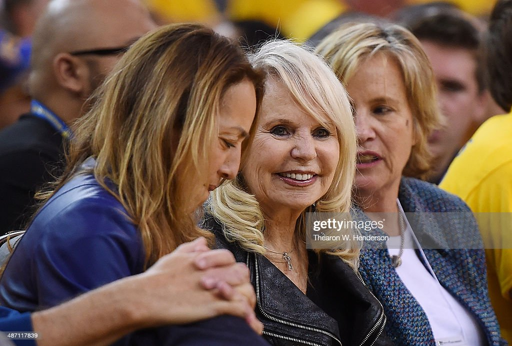Shelly Sterling (C), the wife of Donald Sterling owner of the Los Angeles Clippers, watches the Clippers against the Golden State Warriors in Game Four of the Western Conference Quarterfinals during the 2014 NBA Playoffs at ORACLE Arena on April 27, 2014 in Oakland, California. The players wore theirs warm up this way in protest of owner Donald Sterling's racially insensitive remarks.