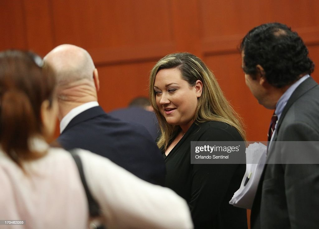 Shelly Zimmerman, center, exits the courtroom for a recess in Seminole circuit court on the fourth day of George Zimmerman's trial, in Sanford, Florida, Thursday, June 13, 2013. Zimmerman is accused in the fatal shooting of Trayvon Martin.