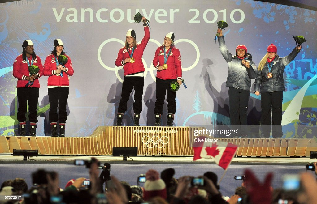 Shelly-Ann Brown and <a gi-track='captionPersonalityLinkClicked' href=/galleries/search?phrase=Helen+Upperton&family=editorial&specificpeople=776844 ng-click='$event.stopPropagation()'>Helen Upperton</a> of Canada receive the silver medal, <a gi-track='captionPersonalityLinkClicked' href=/galleries/search?phrase=Heather+Moyse&family=editorial&specificpeople=809236 ng-click='$event.stopPropagation()'>Heather Moyse</a> and <a gi-track='captionPersonalityLinkClicked' href=/galleries/search?phrase=Kaillie+Humphries&family=editorial&specificpeople=5631265 ng-click='$event.stopPropagation()'>Kaillie Humphries</a> of Canada receive the gold medal and <a gi-track='captionPersonalityLinkClicked' href=/galleries/search?phrase=Elana+Meyers&family=editorial&specificpeople=5631239 ng-click='$event.stopPropagation()'>Elana Meyers</a> and <a gi-track='captionPersonalityLinkClicked' href=/galleries/search?phrase=Erin+Pac&family=editorial&specificpeople=2207715 ng-click='$event.stopPropagation()'>Erin Pac</a> of the United States receive the bronze medal during the medal ceremony for the women's bobsleigh on day 14 of the Vancouver 2010 Winter Olympics at Whistler Medals Plaza on February 25, 2010 in Whistler, Canada.