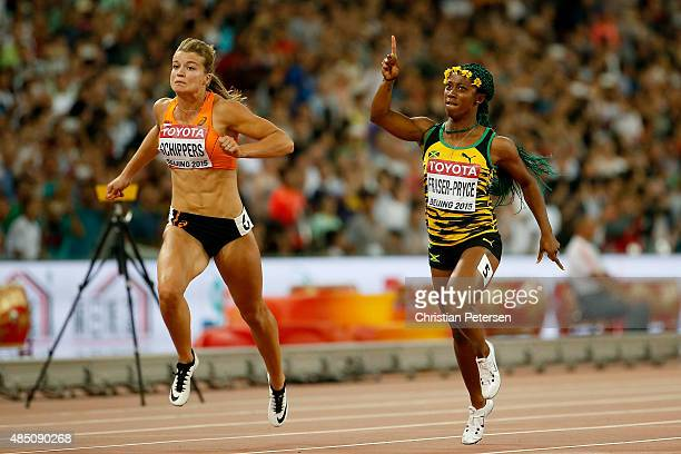 ShellyAnn FraserPryce of Jamaica beats Dafne Schippers of the Netherlands to win gold in the Women's 100 metres final during day three of the 15th...