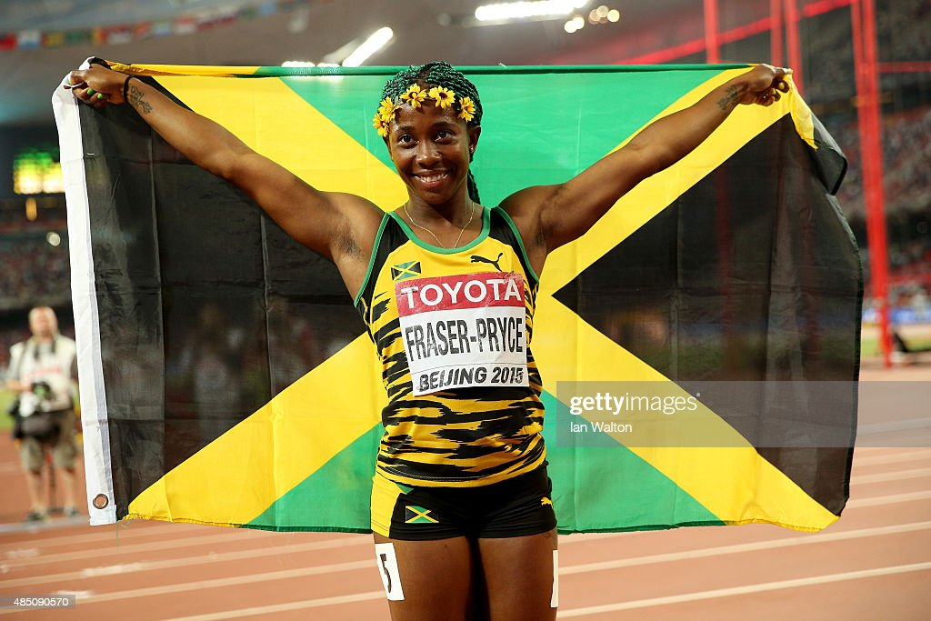 <a gi-track='captionPersonalityLinkClicked' href=/galleries/search?phrase=Shelly-Ann+Fraser&family=editorial&specificpeople=5493833 ng-click='$event.stopPropagation()'>Shelly-Ann Fraser</a>-Pryce of Jamaica celebrates after winning gold in the Women's 100 metres final during day three of the 15th IAAF World Athletics Championships Beijing 2015 at Beijing National Stadium on August 24, 2015 in Beijing, China.
