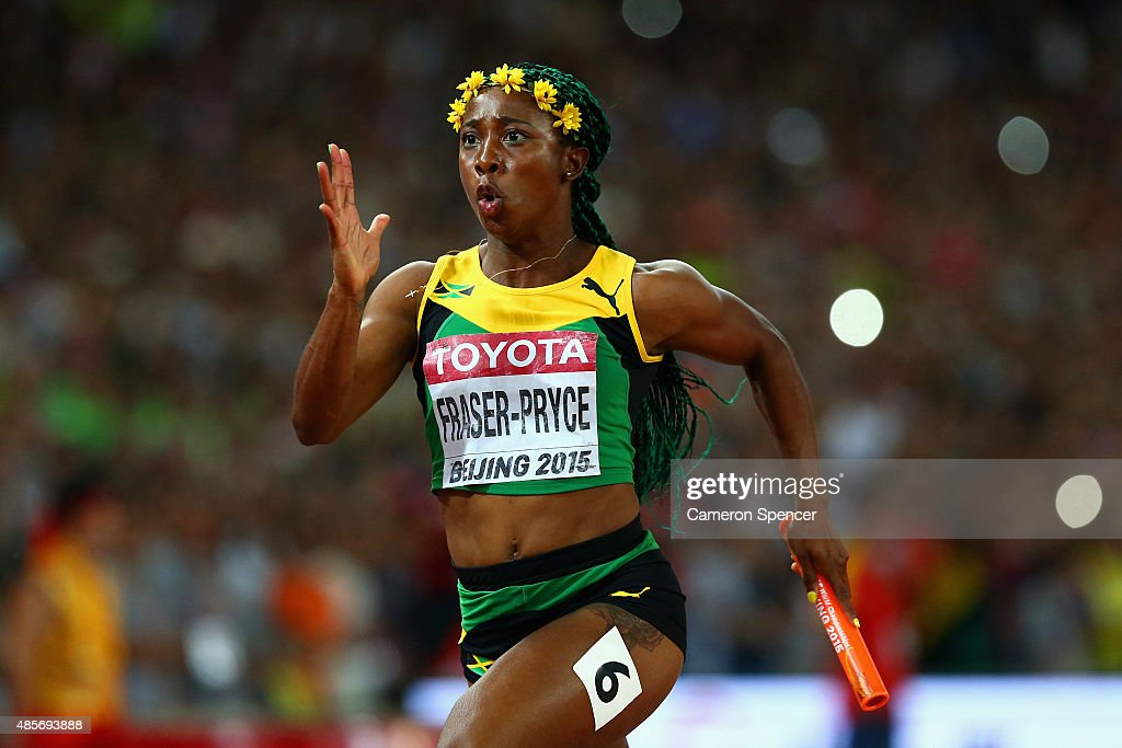 Shelly-Ann Fraser-Pryce of Jamaica crosses the finish line to win gold in the Women's 4x100 Metres Relay final during day eight of the 15th IAAF World Athletics Championships Beijing 2015 at Beijing National Stadium on August 29, 2015 in Beijing, China.
