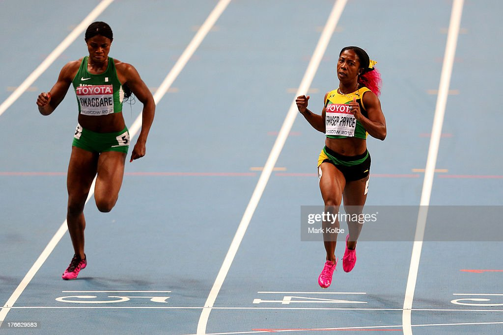 Shelly-Ann Fraser-Pryce of Jamaica crosses the line to win gold ahead of Blessing Okagbare of Nigeria (L) in the Women's 200 metres final during Day Seven of the 14th IAAF World Athletics Championships Moscow 2013 at Luzhniki Stadium at Luzhniki Stadium on August 16, 2013 in Moscow, Russia.
