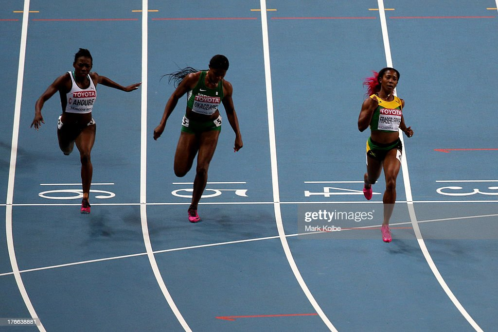 Shelly-Ann Fraser-Pryce of Jamaica crosses the line to win gold ahead of Blessing Okagbare of Nigeria and Murielle Ahoure of Ivory Coast in the Women's 200 metres final during Day Seven of the 14th IAAF World Athletics Championships Moscow 2013 at Luzhniki Stadium at Luzhniki Stadium on August 16, 2013 in Moscow, Russia.